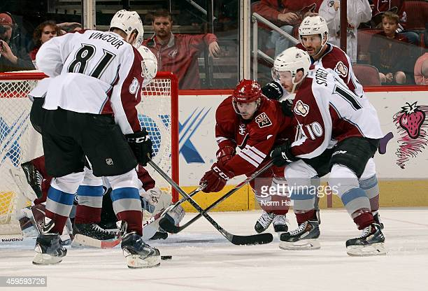 Tobias Rieder of the Arizona Coyotes skates in on goal as Tomas Vincour and Ben Street of the Colorado Avalanche defend during the third period at...