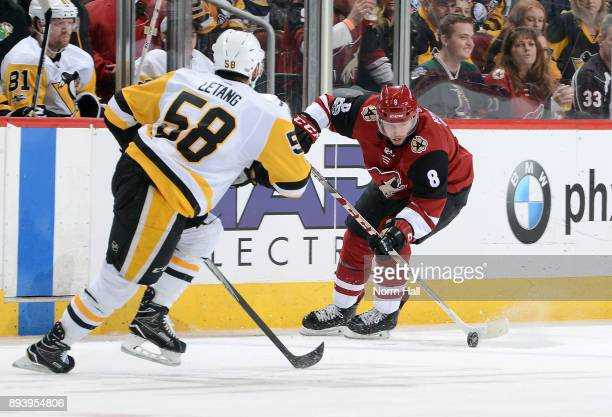 Tobias Rieder of the Arizona Coyotes skates with the puck in front of Kris Letang of the Pittsburgh Penguins during the second period at Gila River...
