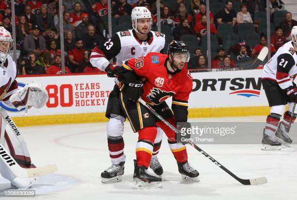 Tobias Rieder of the Calgary Flames battles against Oliver Ekman-Larsson of the Arizona Coyotes at Scotiabank Saddledome on March 6, 2020 in Calgary,...