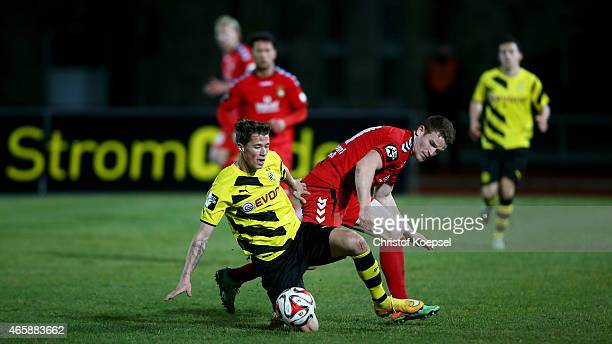 Tobias Ruehle of Sonnenhof Grossaspach challenges Erik Durm of Dortmund II during the Third League match between Borussia Dortmund II and SG...