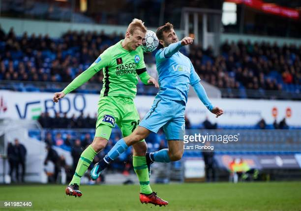 Tobias Salquist of Silkeborg IF and Bashkim Kadrii of Randers FC compete for the ball during the Danish DBU Pokalen Cup quarterfinal match between...