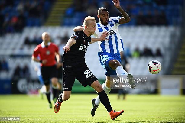 Tobias Salquist of Silkeborg IF and Kenneth Zohore of OB Odense compete for the ball during the Danish Alka Superliga match between OB Odense and...