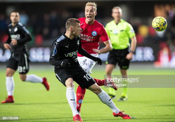 Tobias Salquist of Silkeborg IF and Marvin Pourie of Randers FC compete for the ball during the Danish Alka Superliga match between Silkeborg IF and...
