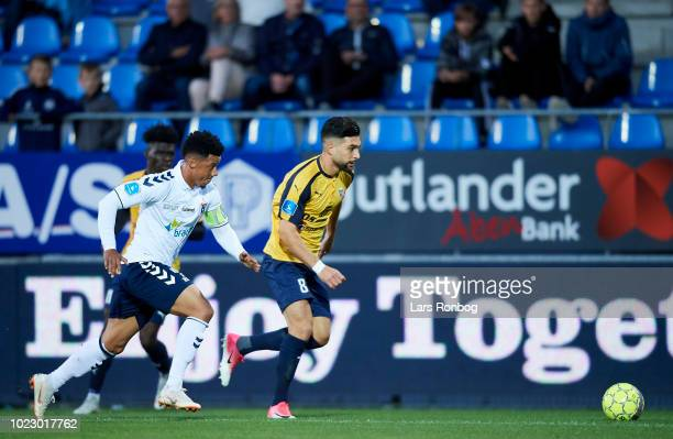 Tobias Sana of AGF Aarhus and Frans Dhia Putros of Hobro IK compete for the ball during the Danish Superliga match between Hobro IK and AGF Aarhus at...