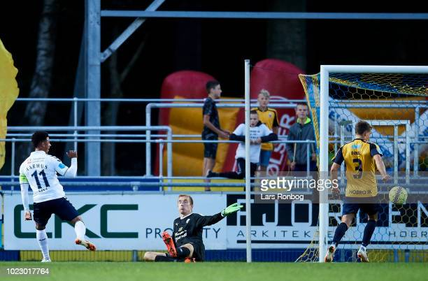 Tobias Sana of AGF Aarhus in action against Goalkeeper Jesper Rask of Hobro IK during the Danish Superliga match between Hobro IK and AGF Aarhus at...