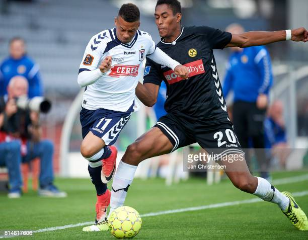 Tobias Sana of AGF Arhus and Mikkel Qvist of AC Horsens compete for the ball during the Danish Alka Superliga match between AGF Arhus and AC Horsens...
