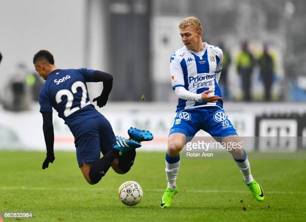 Tobias Sana of Malmo FF and Henrik Bjordal of IFK Goteborg competes for the ball during the Allsvenskan match between IFK Goteborg and Malmo FF at...