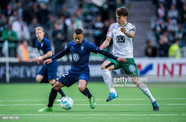 Tobias Sana of Malmo FF and Melker Hallberg of Hammarby IF during the Allsvenskan match between Hammarby IF and Malmo FF at Tele2 Arena on May 18...