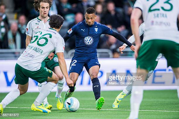 Tobias Sana of Malmo FF challenge the defense of Hammarby IF during the Allsvenskan match between Hammarby IF and Malmo FF at Tele2 Arena on May 18...