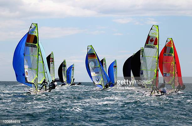 Tobias Schadewaldt and Hannes Baumann of Germany in action during a 49er Class race during day seven of the Weymouth and Portland International...