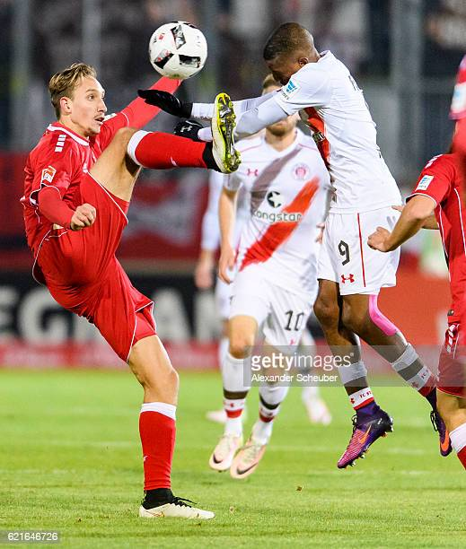Tobias Schroeck of Wuerzburg challenges Fafa Picault of St Pauli during the Second Bundesliga match between FC Wuerzburger Kickers and FC St Pauli at...