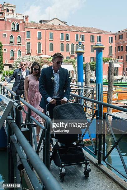 Tobias Schweinsteiger brother of Bastian Schweinsteiger and girlfriend Sarah arrive with son Max Liam at the wedding hall at Palazzo Cavalli before...