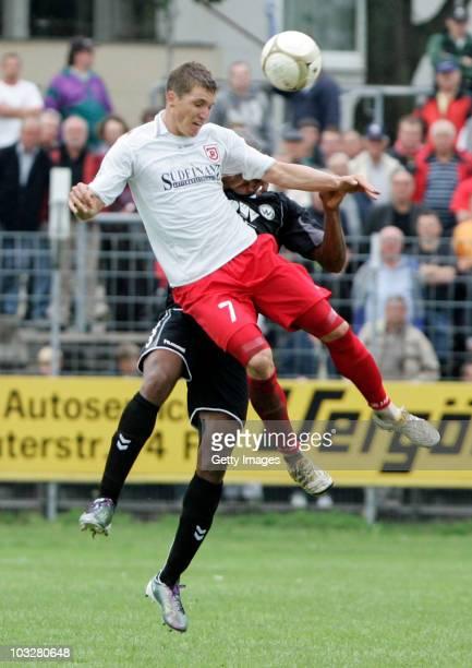 Tobias Schweinsteiger of SSV Jahn Regensburg jumps for a header during the Third League match between SSV Jahn Regensburg and Wacker Burghausen at...