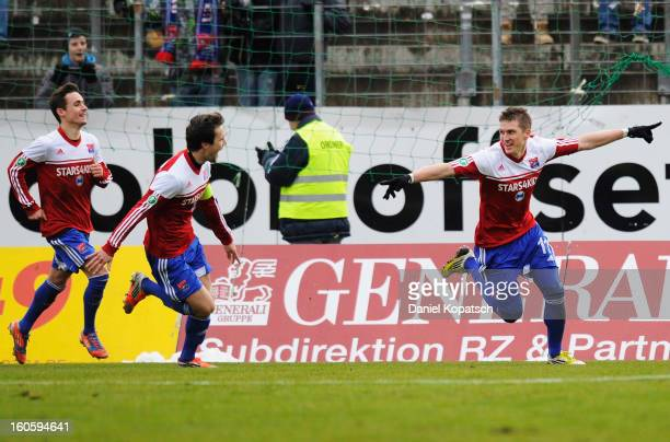 Tobias Schweinsteiger of Unterhaching celebrates his team's first goal with team mates Stephan Thee and Dominik Rohracker during the third Bundesliga...