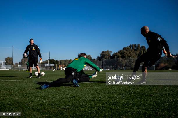 Tobias Sippel, Goalkeeper Coach Uwe Kamps and Goalkeeper Coach Steffen Krebs of Borussia Moenchengladbach in action during a training session at...
