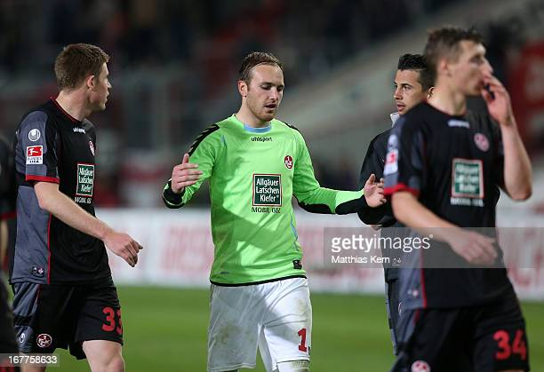 Tobias Sippel of Kaiserslautern and his team mates show their frustration after loosing the Second Bundesliga match between FC Energie Cottbus and...
