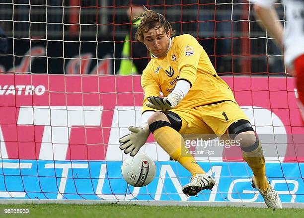 Tobias Sippel of Kaiserslautern concedes the 11 goal scored by Heinrich Schmidtgal of Oberhausen during the Second Bundesliga match between RotWeiss...