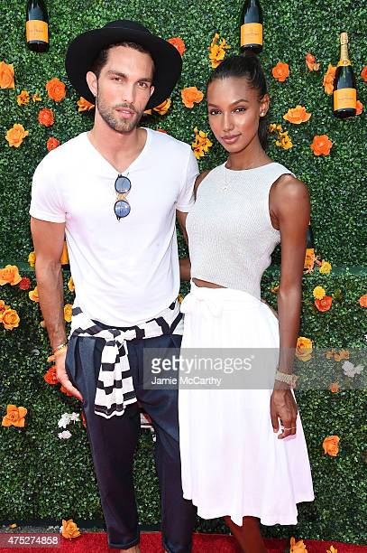 Tobias Sorensen and Jasmine Tookes attend the EighthAnnual Veuve Clicquot Polo Classic at Liberty State Park on May 30 2015 in Jersey City New Jersey