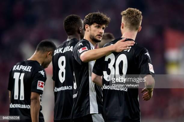Tobias Strobl and Nico Elvedi of Borussia Moenchengladbach react after the Bundesliga match between FC Bayern Muenchen and Borussia Moenchengladbach...