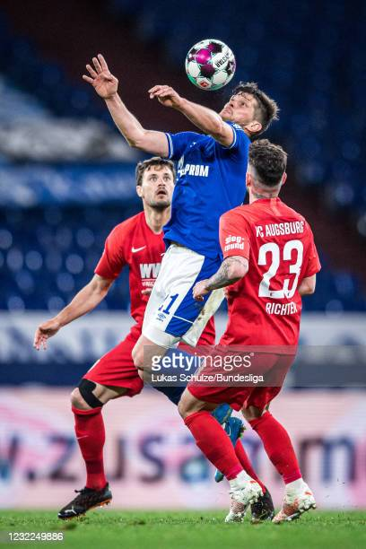 Tobias Strobl of Augsburg, Klaas-Jan Huntelaar of Schalke and Marco Richter of Augsburg in action during the Bundesliga match between FC Schalke 04...
