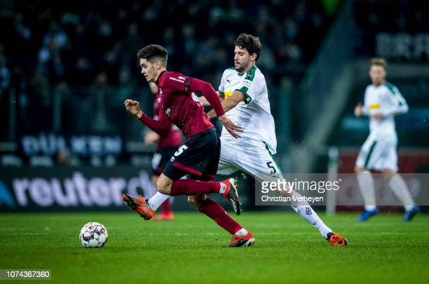Tobias Strobl of Borussia Moenchengladbach and Alexander Fuchs of 1FC Nuernberg battle for the ball during the Bundesliga match between Borussia...