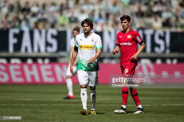 Tobias Strobl of Borussia Moenchengladbach and Kai Havertz of Bayer 04 Leverkusen battle for the ball during the Bundesliga match between Borussia...