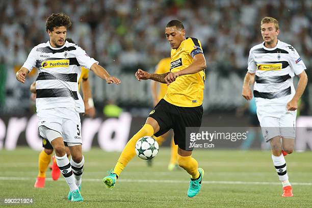 Tobias Strobl of Borussia Moenchengladbach challenges Guillaume Hoarau of Young Boys Bern during the Champions League Playoff match between Young...