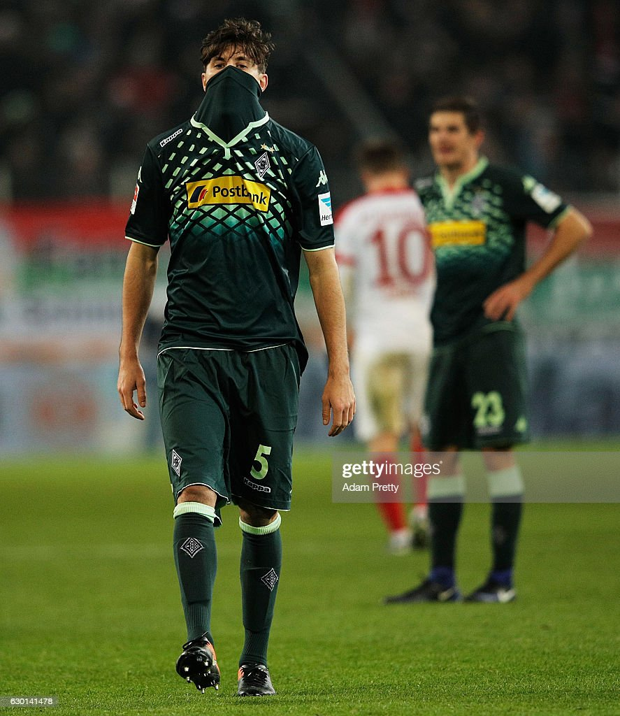 Tobias Strobl of Borussia Moenchengladbach is dejected after losing the Bundesliga match between FC Augsburg and Borussia Moenchengladbach at WWK Arena on December 17, 2016 in Augsburg, Germany.