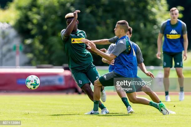 Tobias Strobl of Borussia Moenchengladbach Laszlo Benes of Borussia Moenchengladbach and BaMuaka Simakala of Borussia Moenchengladbach battle for the...