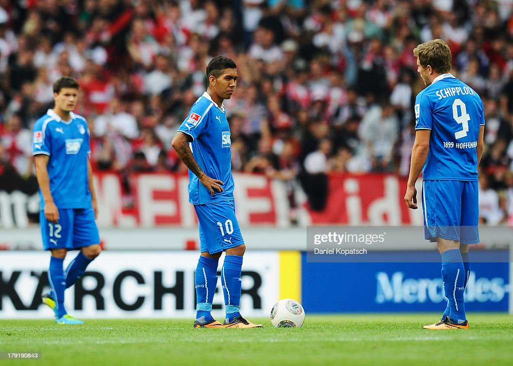 Tobias Strobl of Hoffenheim (L-R), Roberto Firmino of Hoffenheim and Sven Schipplock of Hoffenheim react during the Bundesliga match between VfB Stuttgart and 1899 Hoffenheim at Mercedes-Benz Arena on September 1, 2013 in Stuttgart, Germany.
