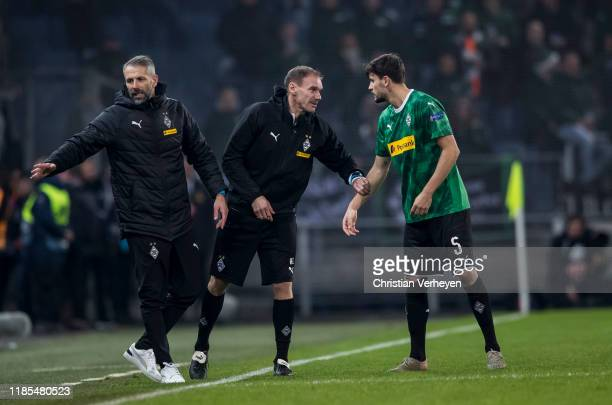 Tobias Strobl talks to Assistant Coach Alexander Zickler of Borussia Moenchengladbach during the Group J UEFA Europa League match between Wolfsberger...