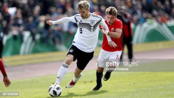 Tobias Svendsen of Norway challenges Arne Maier of Germany during the UEFA Under19 European Championship Qualifier match between Germany and Norway...