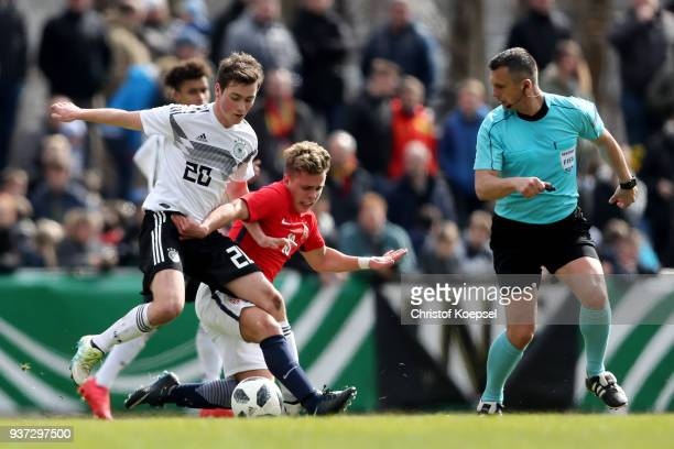 Tobias Svendsen of Norway challenges Yari Otto of Germany during the UEFA Under19 European Championship Qualifier match between Germany and Norway at...