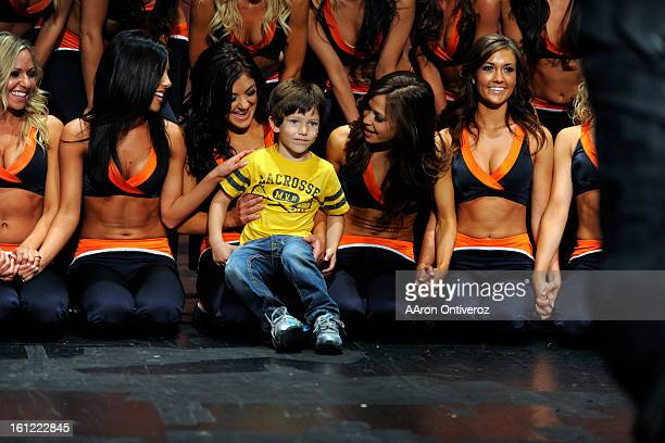 Tobias Tilley poses with the team during Broncos cheerleader tryouts at the Performing Arts Complex at PCS in Federal Heights on April 22 2012 AAron...