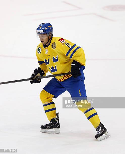 Tobias Tornkvist of Team Sweden skates against Team USA during the 2013 USA Hockey Junior Evaluation Camp at the Lake Placid Olympic Center on August...