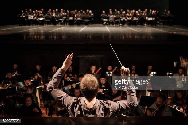 Tobias Volkmann conductor of the Rio de Janeiro Theatro Municipal symphony orchestra conducts during the last rehearsal of Carl Orff's 'Carmina...