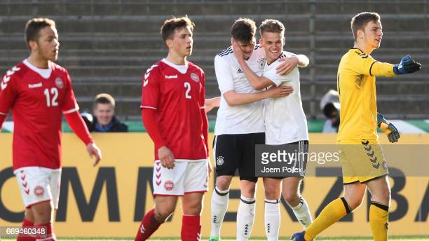 Tobias Warschewski of Germany celebrates with his team mate Niklas Shipnoski after scoring his team's first goal during the international friendly...