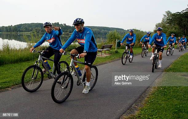Tobias Weis and Boris Vukcevic and team mates drive their bicycles during a training camp of 1899 Hoffenheim on June 30, 2009 in Stahlhofen am...