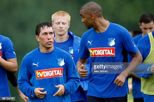 Tobias Weis chats with team mate Marvin Compper during a training session of 1899 Hoffenheim during a training camp on June 30, 2009 in Stahlhofen am...