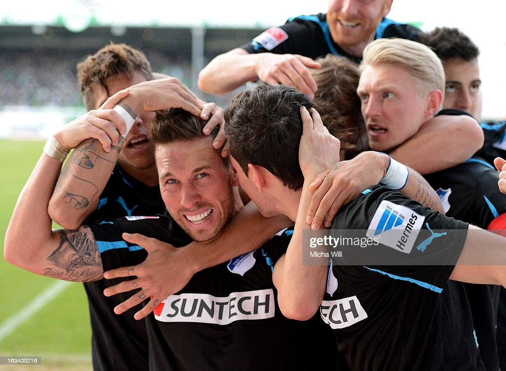 Tobias Weis (2nd L) of Hoffenheim celebrates the third goal for his team with teammates during the Bundesliga match between SpVgg Greuther Fuerth and TSG 1899 Hoffenheim at Trolli-Arena on March 9, 2013 in Fuerth, Germany.