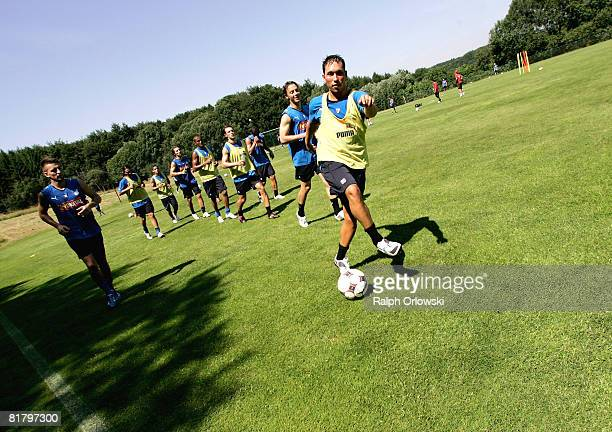 Tobias Weis of TSG 1899 Hoffenheim and his teammates attend a training session at their training camp on July 2, 2008 in Stahlhofen near Limburg,...