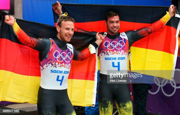 Tobias Wendl and Tobias Arlt of Germany celebrate after winning the gold medal during the Men's Luge Doubles on Day 5 of the Sochi 2014 Winter...
