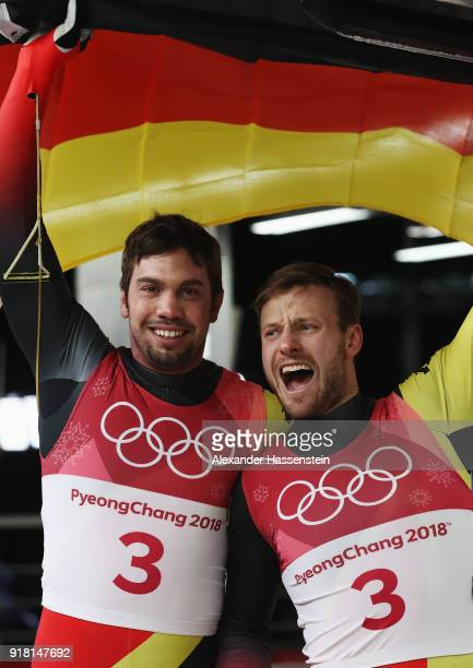 Tobias Wendl and Tobias Arlt of Germany celebrate as they win gold during the Luge Doubles on day five of the PyeongChang 2018 Winter Olympics at the...