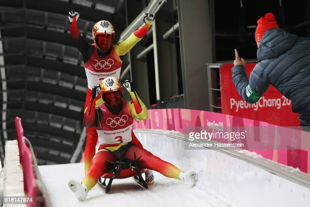 Tobias Wendl and Tobias Arlt of Germany celebrate at the finish as they win gold during the Luge Doubles on day five of the PyeongChang 2018 Winter...