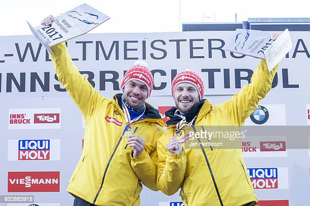 Tobias Wendl and Tobias Arlt of Germany pose for pictures after winning the third place of the Sprint Men Double Final during the FILSprint World...