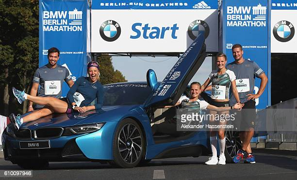 Tobias Wendl Miriam Goessner Anna Hahner and Lisa Hahner Johannes Lochner all members of the BMW Wintersport relay team pose with a BMW i8 the...