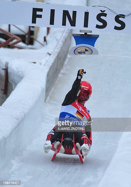 Tobias Wendl of Germany reacts during the Luge World Cup team relay competition on December 16 2012 in Sigulda Latvia some 50 km northeast of Riga...