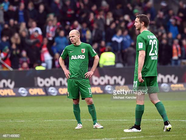 Tobias Werner and Tim Matavz of FC Augsburg look dejected after the Bundesliga match between SC Freiburg and FC Augsburg at SchwarzwaldStadium on...