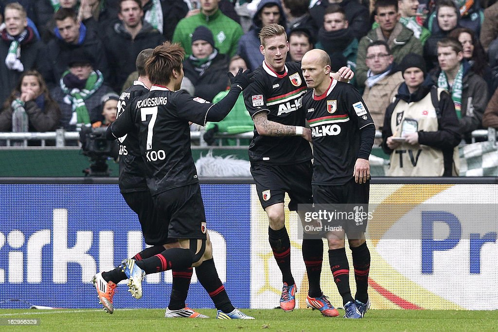 Tobias Werner (R) of Augsburg celebrates his first goal during the Bundesliga match between SV Werder Bremen and FC Augsburg at Weser Stadium on March 2, 2013 in Bremen, Germany.
