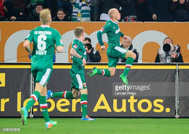 Tobias Werner of Augsburg celebrates his opening goal during the Bundesliga match between FC Augsburg and FC Schalke 04 at SGL Arena on March 14 2014...